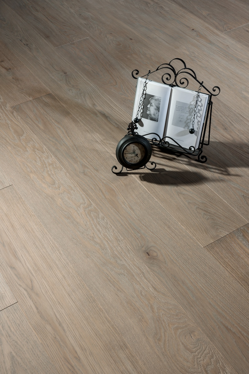 batiste european oak floor with a clock and book