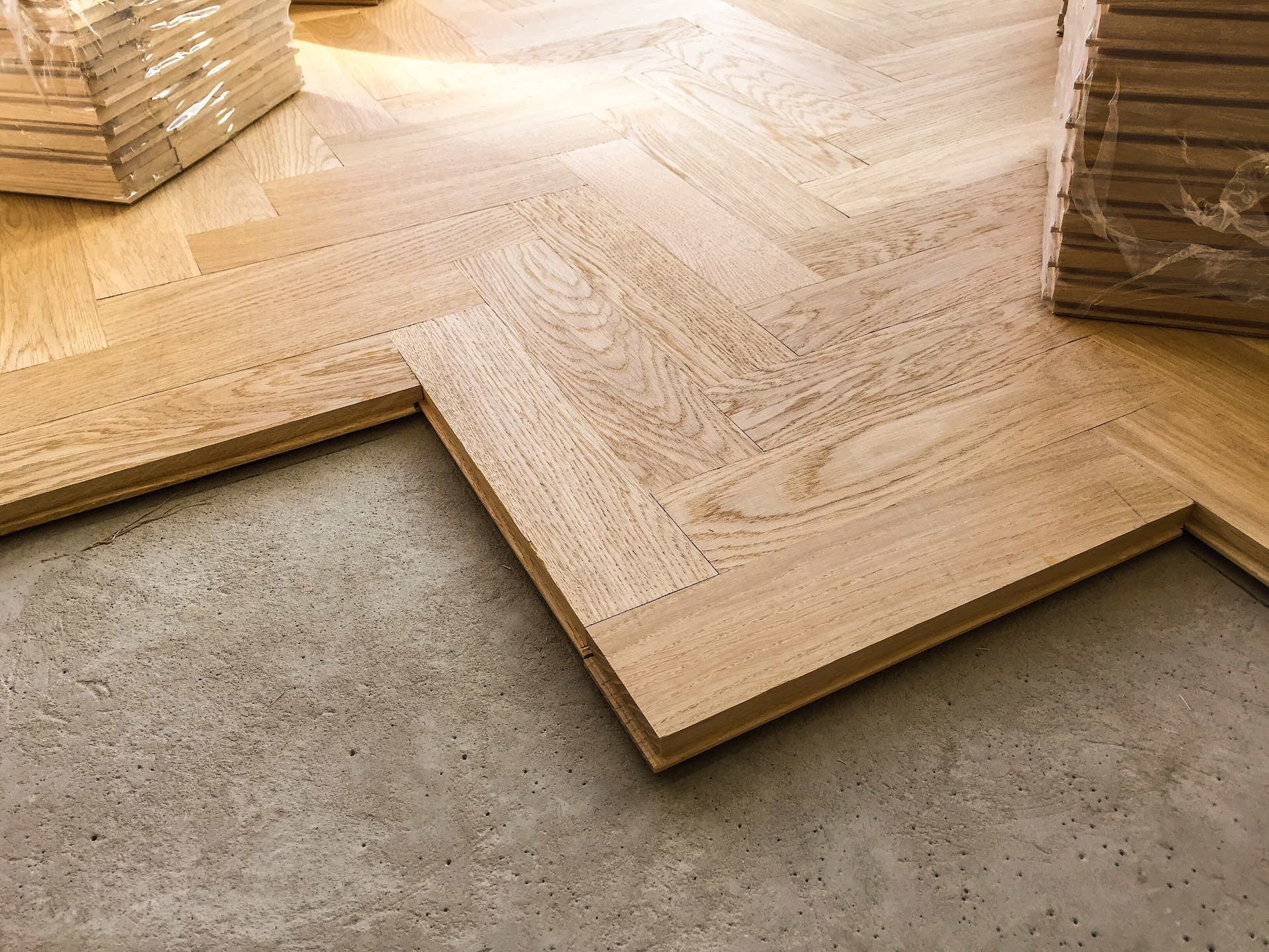 wood parquet flooring being laid on a kitchen floo PWGD5AH